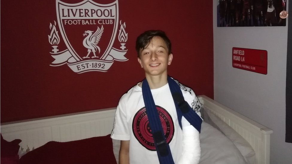 Liverpool FC fan Jacob with broken arm