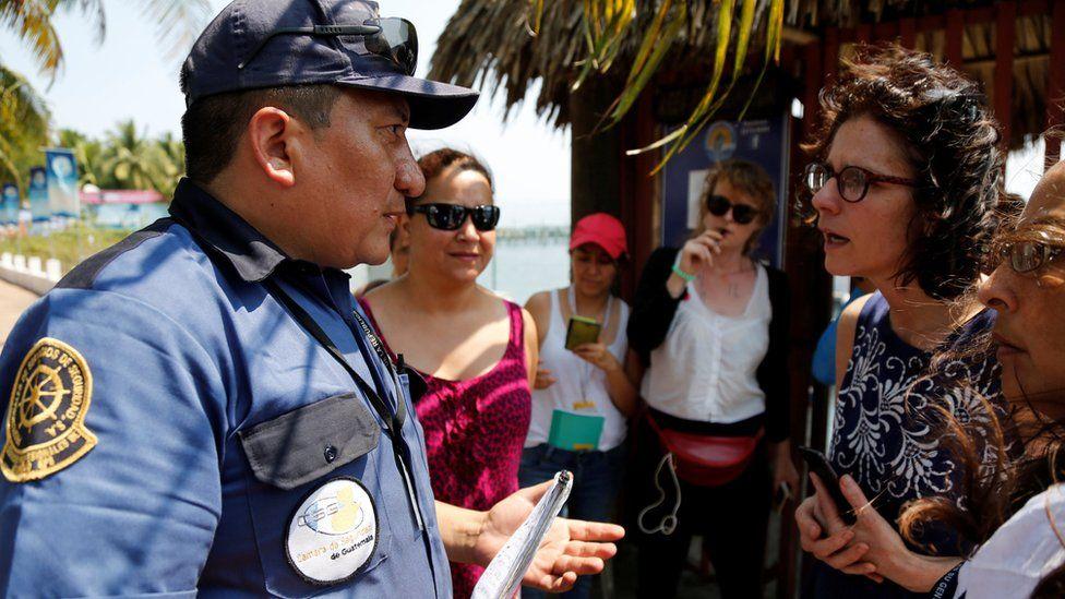 A guard faces members of Women on Waves, 24 Feb 2017, Guatemala