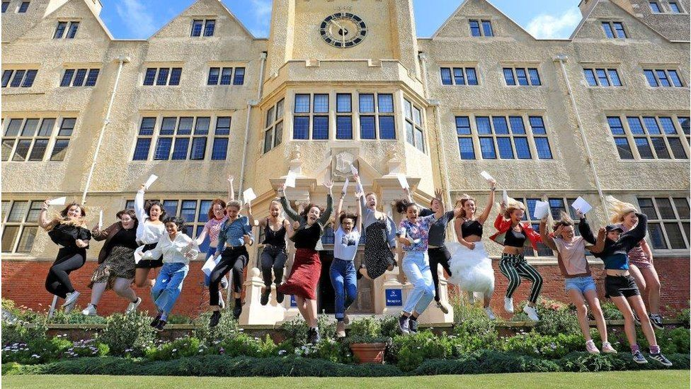 Girls jumping with A-level result papers - Roedean School