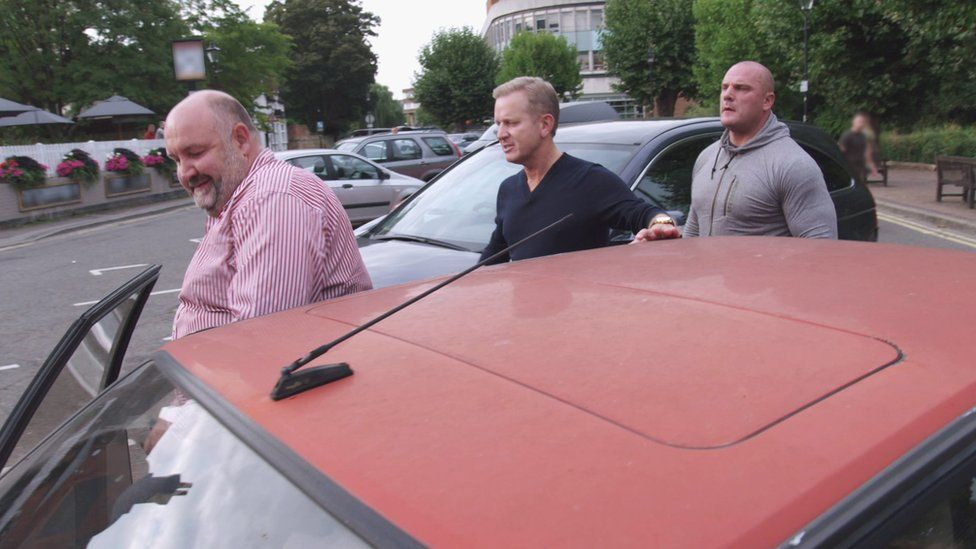 Jeremy Kyle getting out of a car