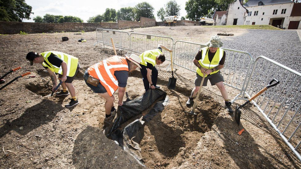 Members of the Waterloo Uncovered team are seen at work