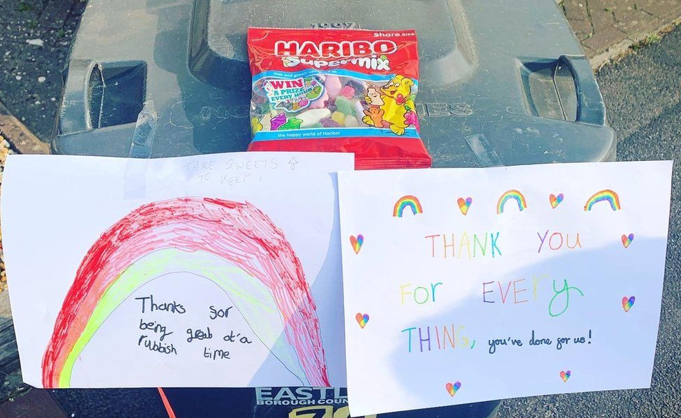 Thank you signs with rainbows and sweets attached to bins