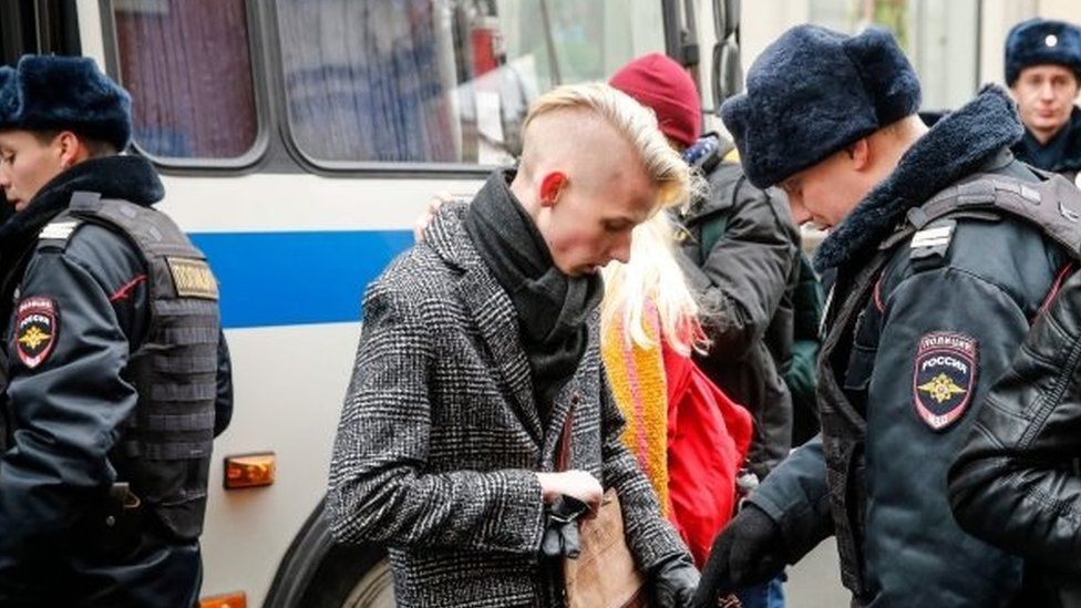 A supporter of nationalist politician Vyacheslav Maltsev being searched by police in Moscow (05 November 2017)