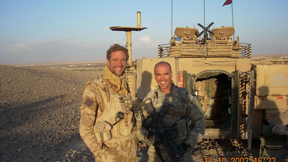 Nöel Lipana (right) beside a British Army officer in Afghanistan