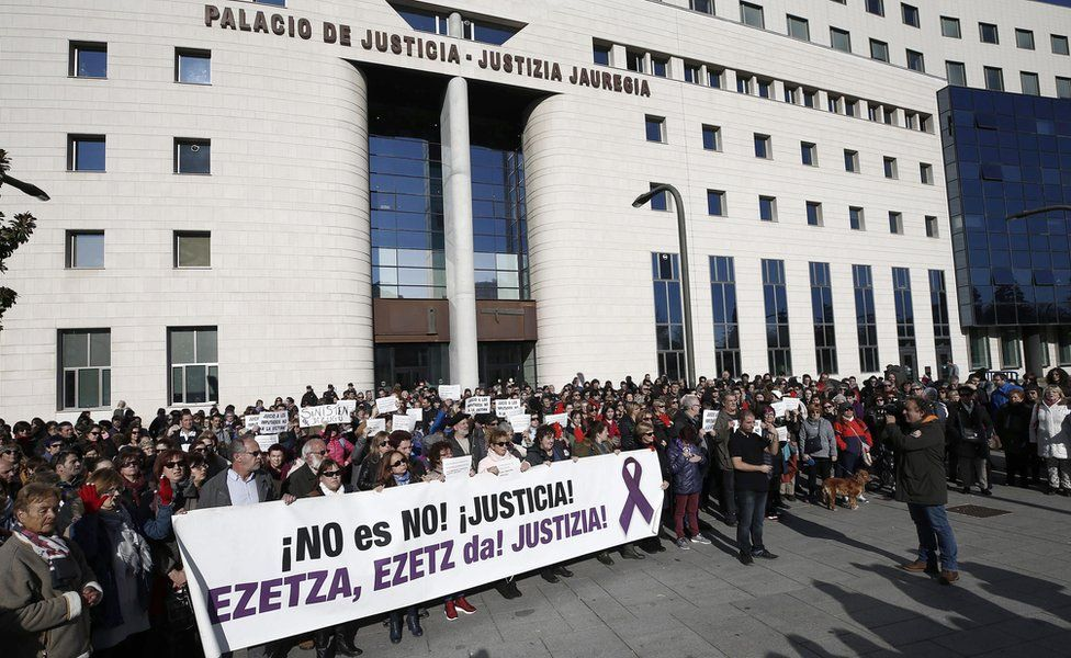 """Protesters show a banner that reads """"No is no. Justice!"""" during a protest held at the Superior Court of Navarra"""