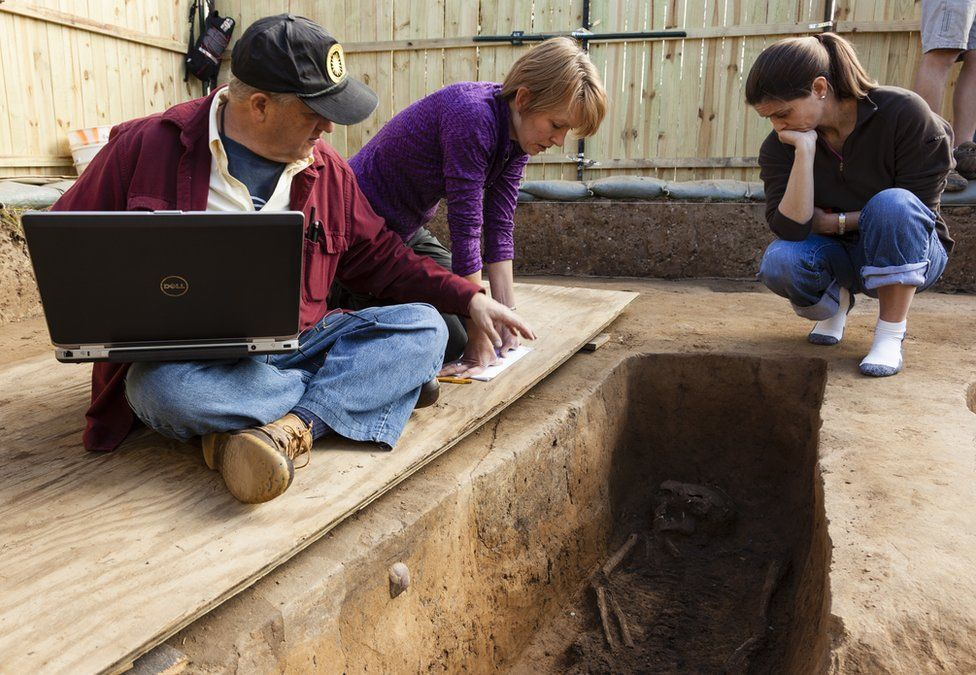 Forensic anthropologist examine the grave of Rev Robert Hunt