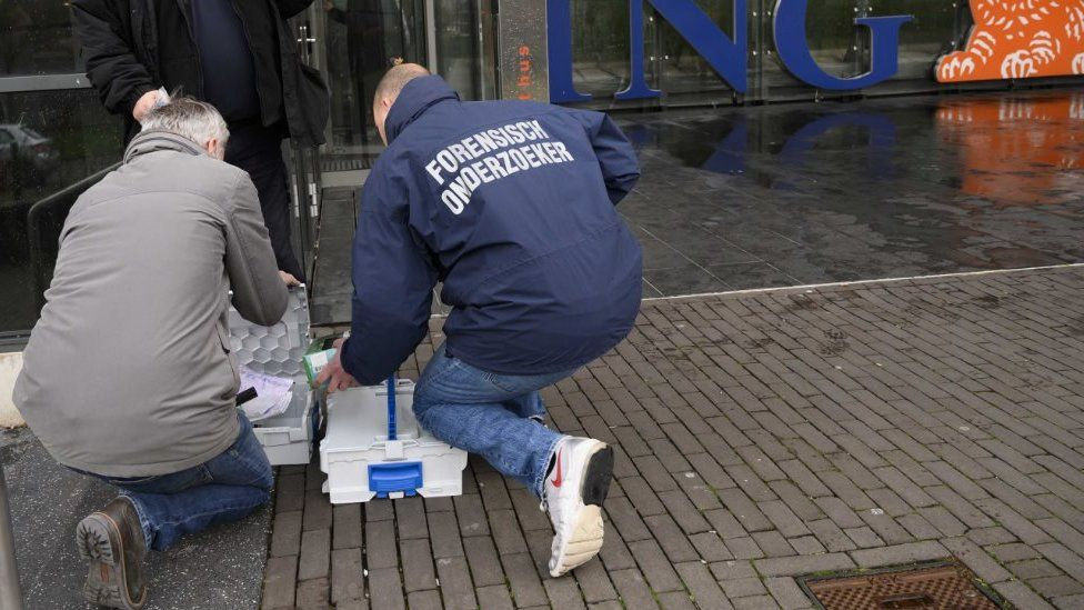 Forensic scientists at the scene of the ING attack on 13 February