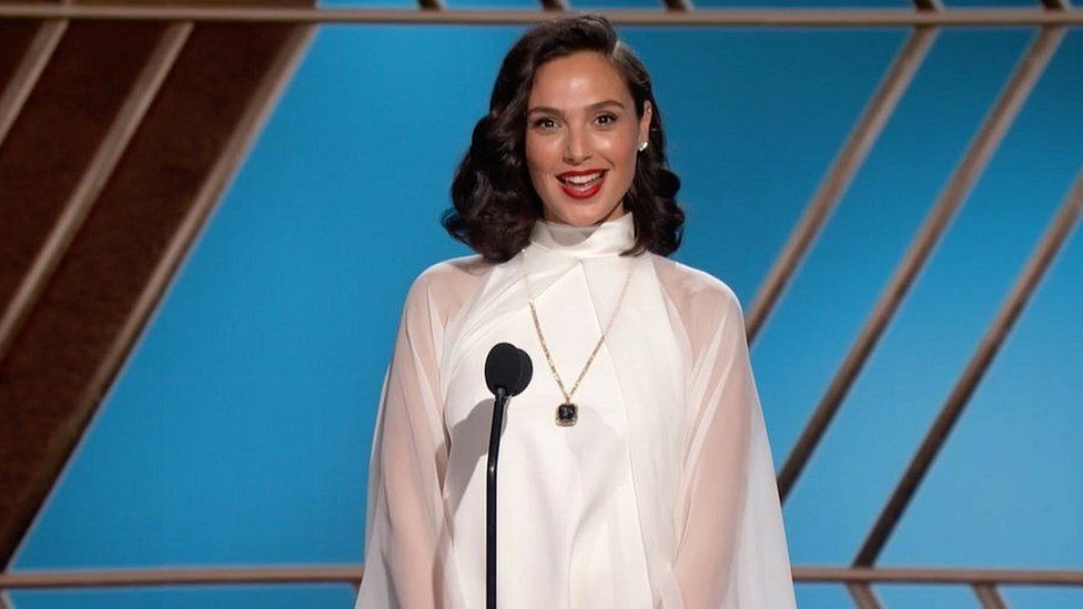 Gal Gadot presents an award