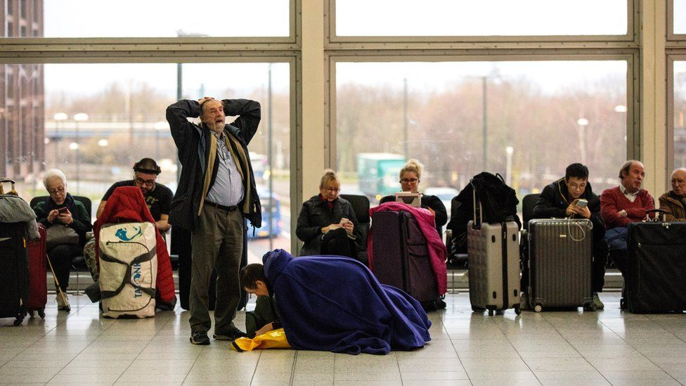 Passengers wait in the South Terminal building at London Gatwick Airport after flights resumed earlier