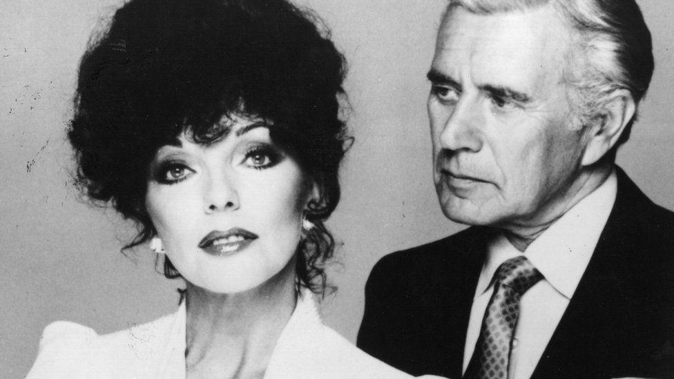 Joan Collins and John Forsythe