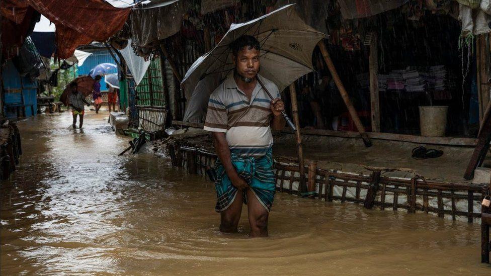 Men wading through flooded street