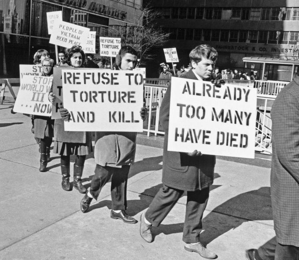 """Philadelphia protesters hold signs saying """"refuse to torture and kill'"""