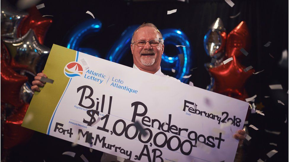 Bill Pendergast with his novelty cheque