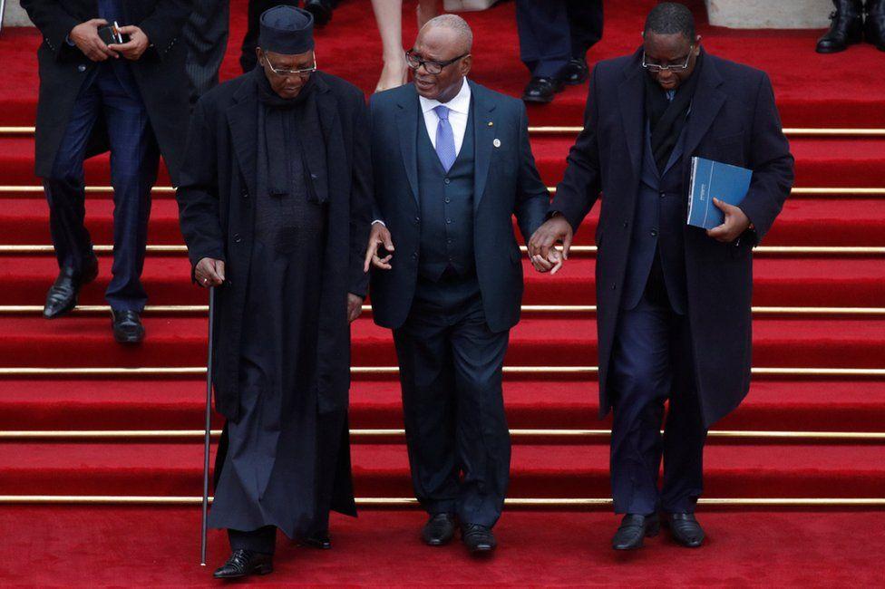 Chad's President Idriss Deby (L), Mali's leader Ibrahim Boubacar Keita (C) and Senegalese President Macky Sall (R) leave the Elysee Palace, Paris, France - Sunday 11 November 2018