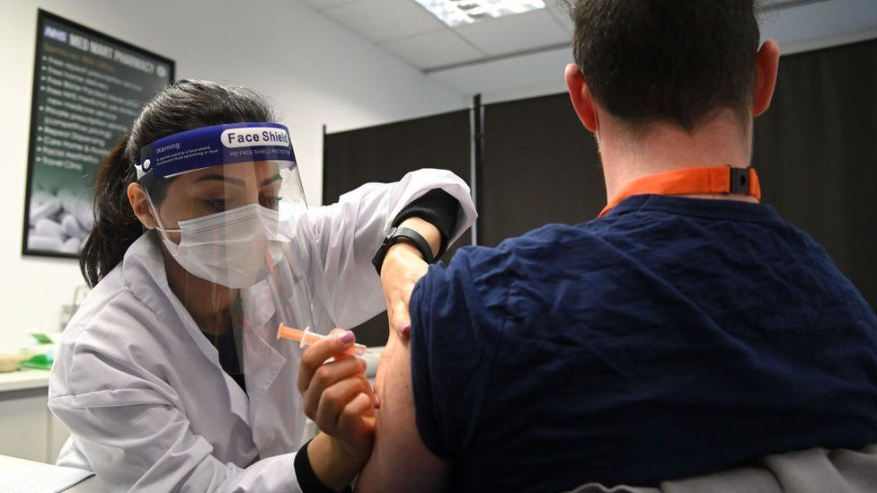 A care home worker in Borehamwood, Hertfordshire, being vaccinated