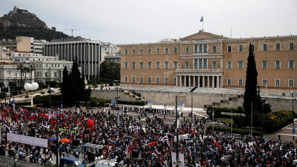 Members of the communist-affiliated PAME union take part in a rally in Athens.