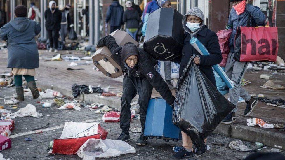 Looters take away few items left to grab in a vandalised mall in Vosloorus, on July 14, 2021