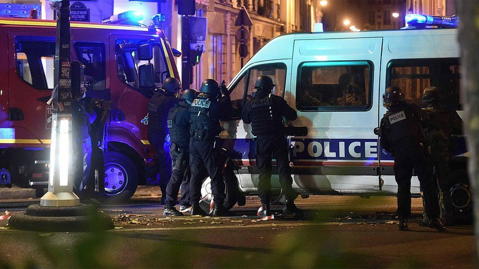 Police officers outside the Bataclan concert venue in Paris, amid reports of hostage-taking