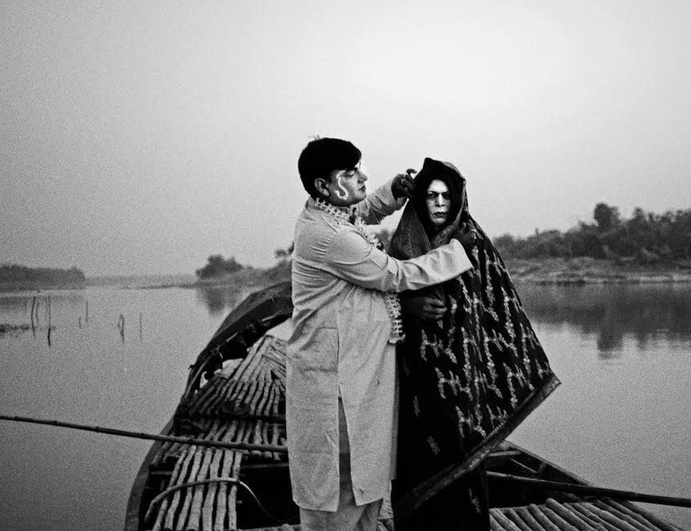 Rabin Kumar Majhi(51yrs) and Anukul Ghosh(63 yrs) posing for a portrait as a newly married couple. Anukul Ghosh used to play female characters in Jatra during 1970-80. Pathra, India.