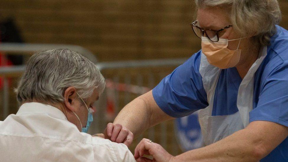 A man gets a vaccine