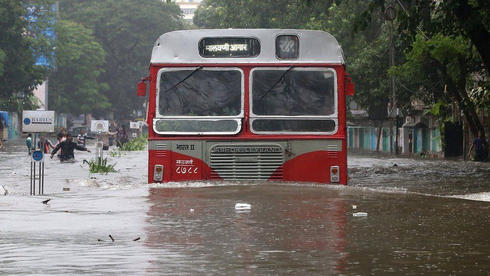 A bus tried to make it down a road in flooded Mumbai, 29 August 2017