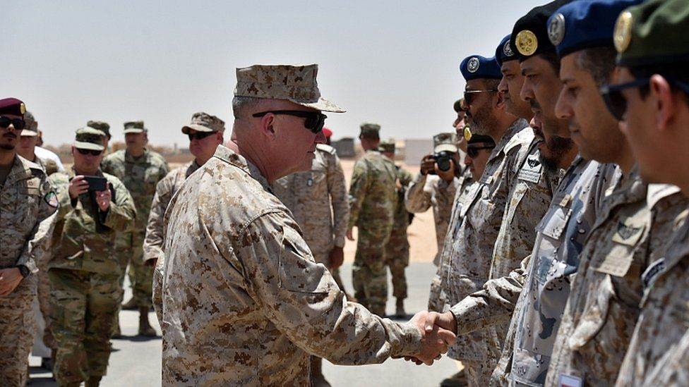 US Marine Corps Gen Kenneth McKenzie Jr shakes hands with Saudi military officers during his visit to a military base in al-Kharj in central Saudi Arabia on July 18, 2019