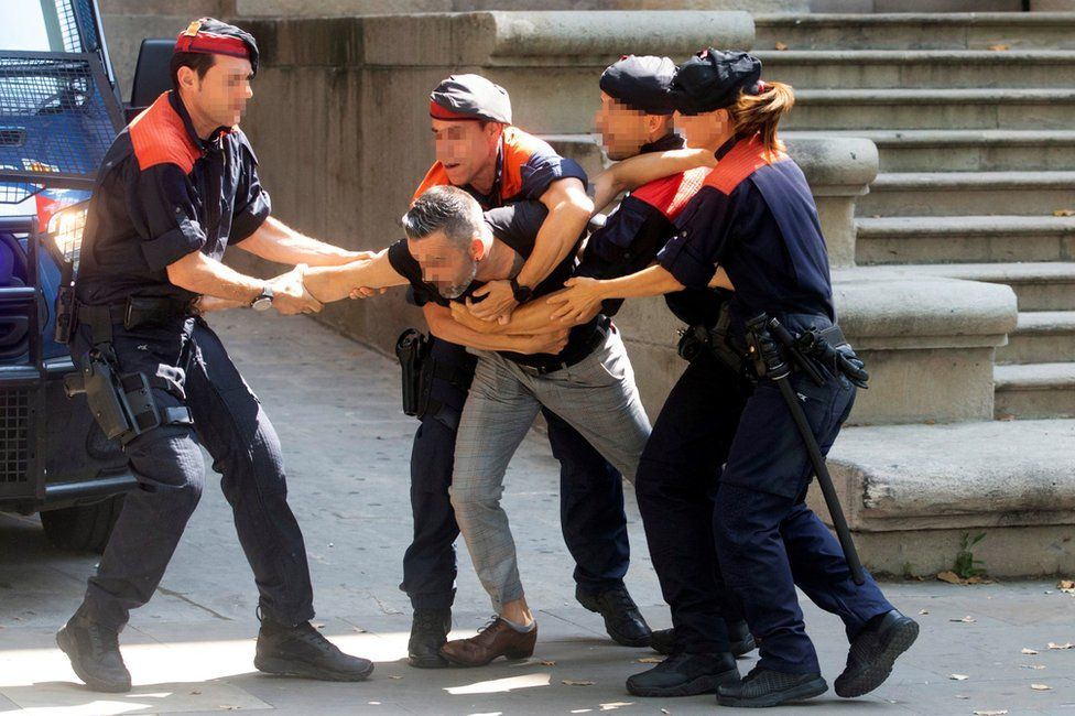 Police restrain the girl's uncle in Barcelona, 3 July
