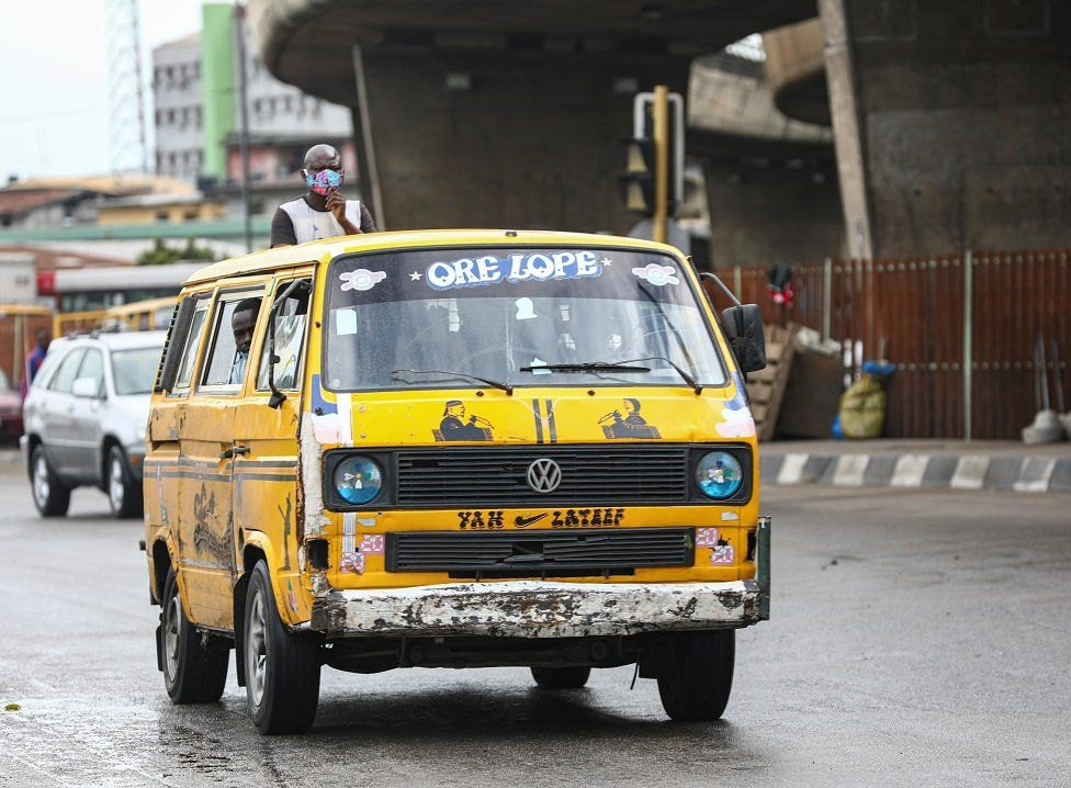 A yellow minibus taxi