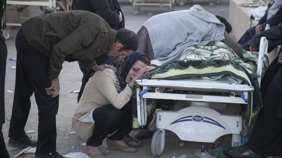 A woman mourns the death of a victim.
