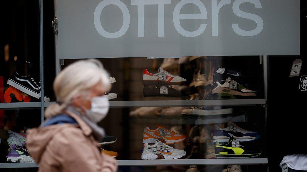 Shopper wearing face coverings