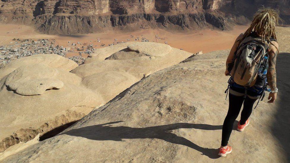 Tara coming down from the summit of Jebel Rum in the Wadi Rum desert in Jordan