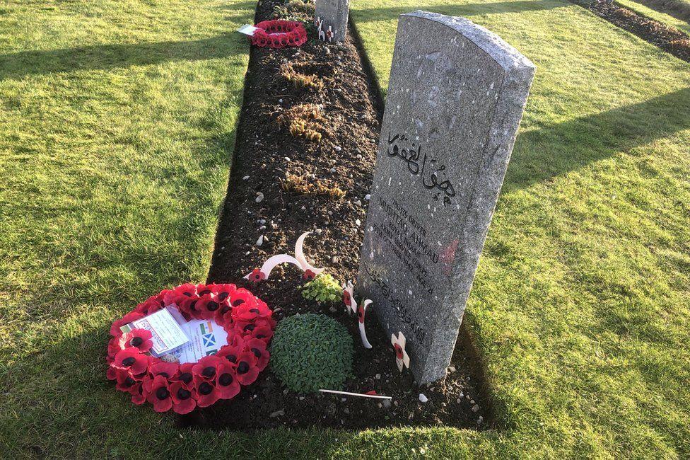 Wreaths laid on graves