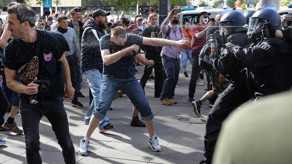 Police use pepper spray in a clash with anti-lockdown demonstrators in Berlin