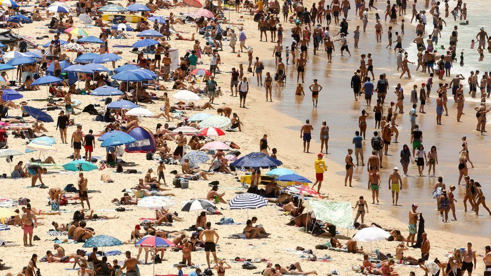 People basking in the sun at Sydney's Bondi Beach on a hot summer day in Australia, 7 January 2018