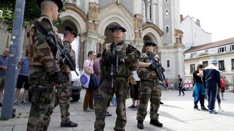 French soldiers patrol on the streets of Saint-Etienne