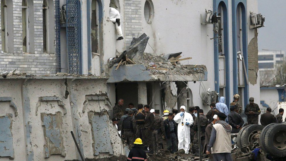 A forensic expert at the scene of a suicide attack in Afghanistan
