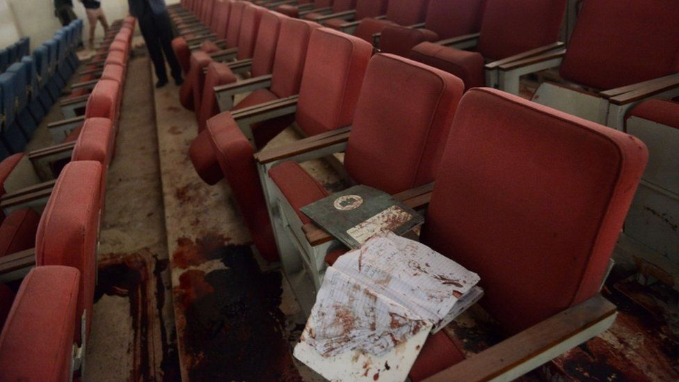 a bloodied ceremony hall at an army-run school