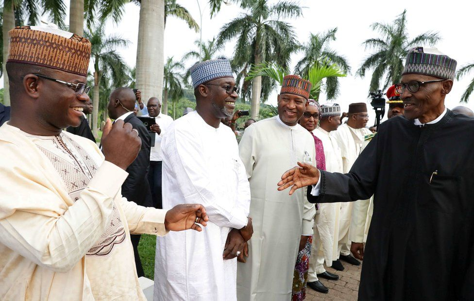 """Nigeria""""s President Muhammadu Buhari is received by some state governors at at Nnamdi Azikiwe airport in Abuja, Nigeria August 19, 2017 after his return from three months medical trip in Britain. Nigeria Presidency"""