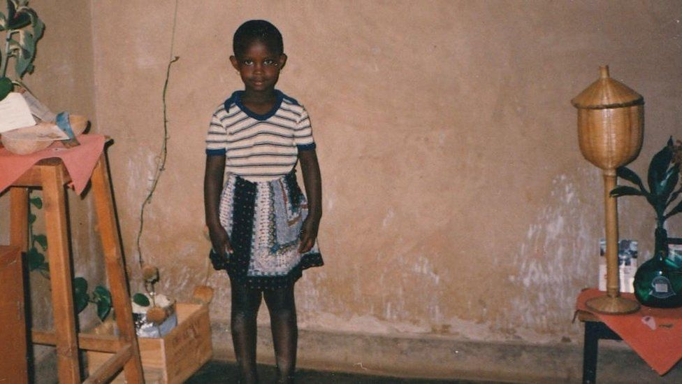 A young girl in her house