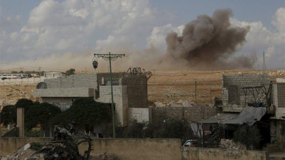 Smoke rising at Maasran, southern Idlib province, 7 October.