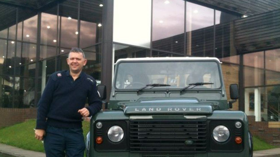 Simon Collins with his latest Defender, a 2013 Defender 90