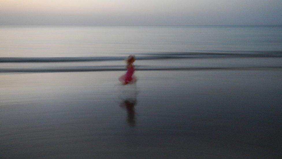 Girl running on a beach