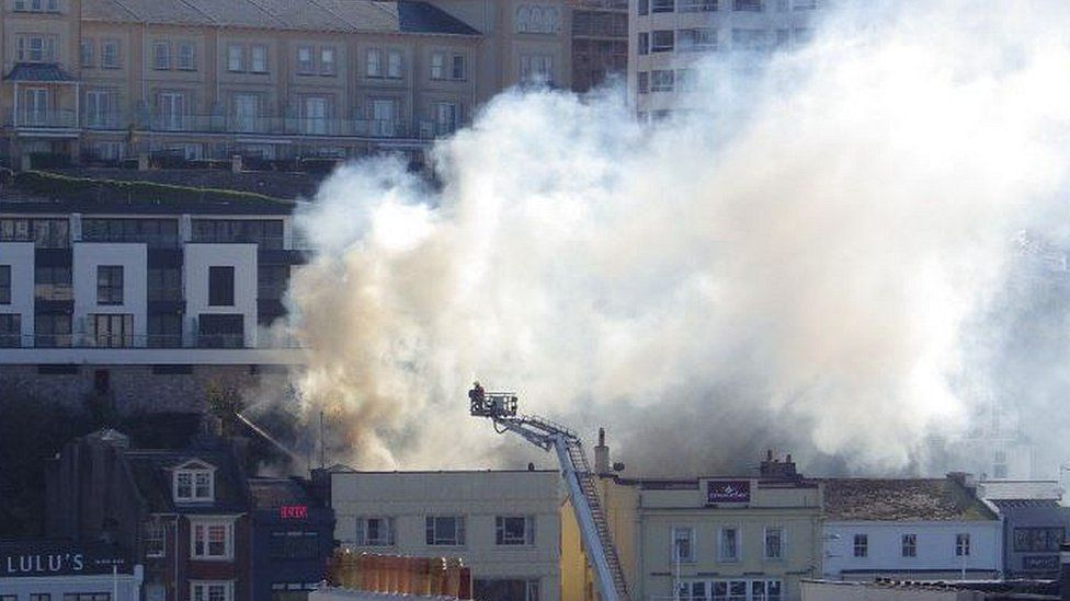 Smoke billowing out of the rooftop