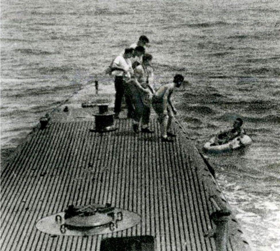 George Bush in a dinghy being rescued after he was shot down in 1944
