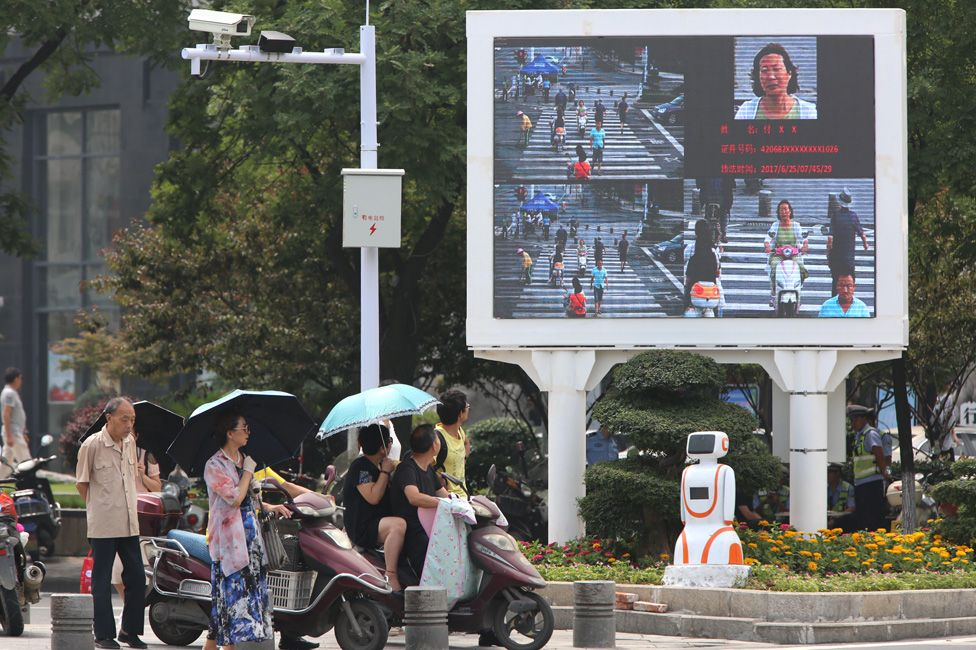 Facial recognition equipment and a screen designed to shame jaywalkers at a busy intersection in Xiangyang on 26 June 2017