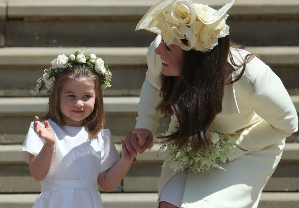 Princess Charlotte waves next to her mother, the Duchess of Cambridge