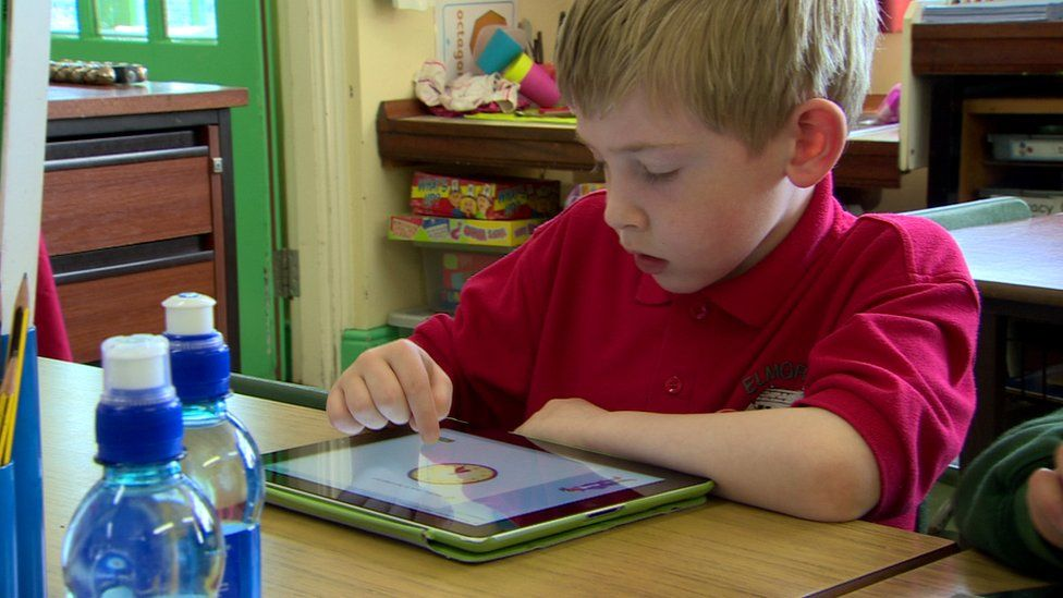 Pupil with iPad