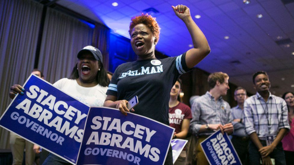 Supporters of Stacey Abrams celebrate her win on the night of the Democratic primary election.