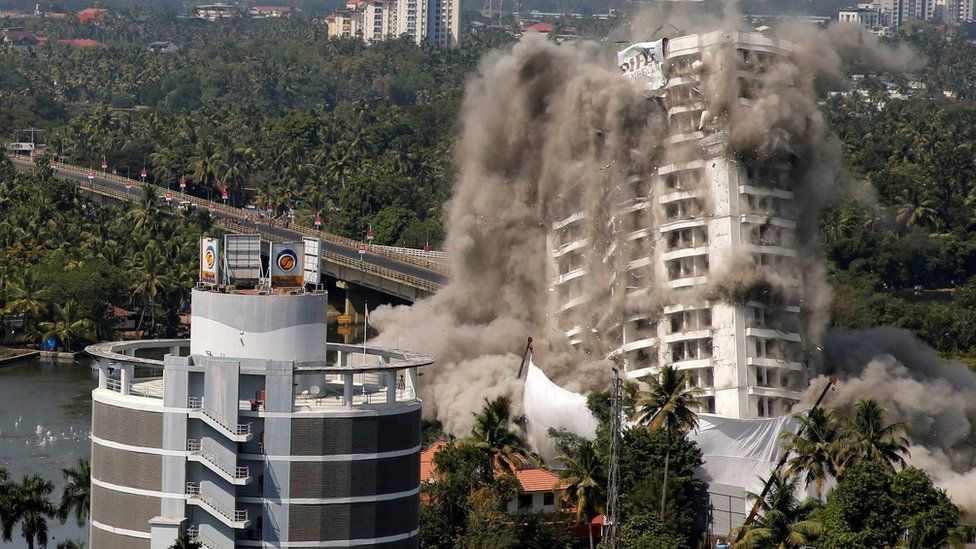A high-rise residential building is demolished with controlled blasting in Kochi, India, 11 January, 2020.