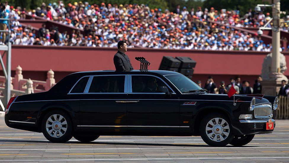 Xi Jinping in a FAW Hongqi at a military parade.